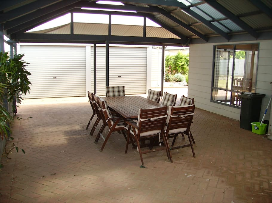 Outdoor setting and bbq for your use under carport