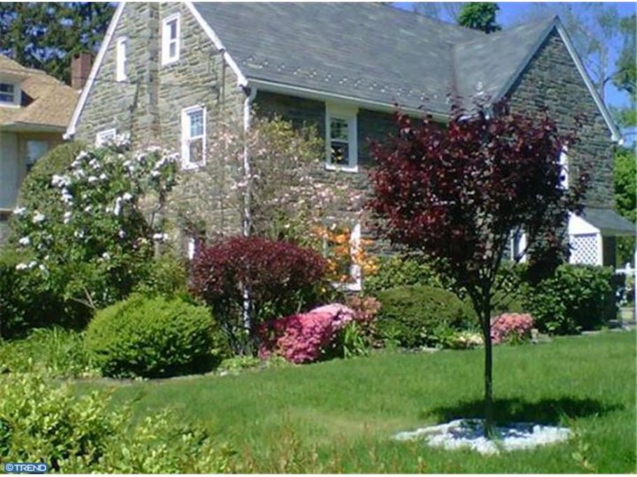 Large front yard with colorful landscaping