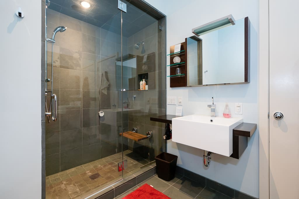 Shower has dual shower heads and steam generator.