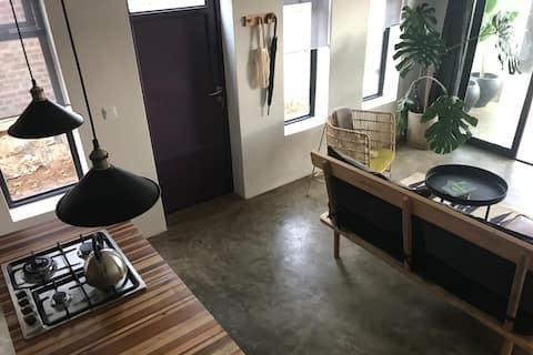 La Puerta Púrpura - un dormitorio en Kacyiru