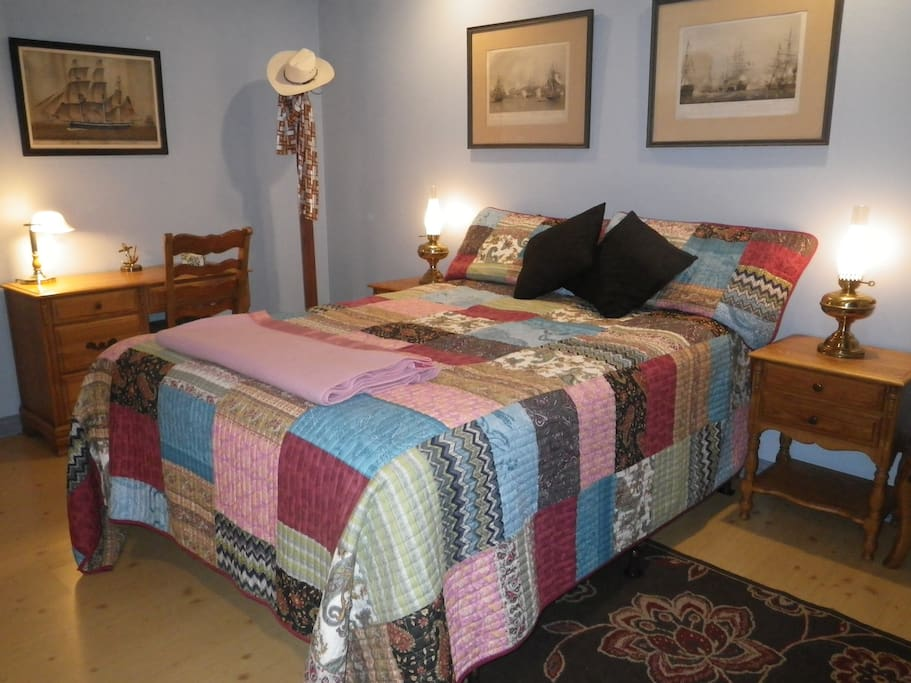 Nice queen bed with new linens and plenty of light.