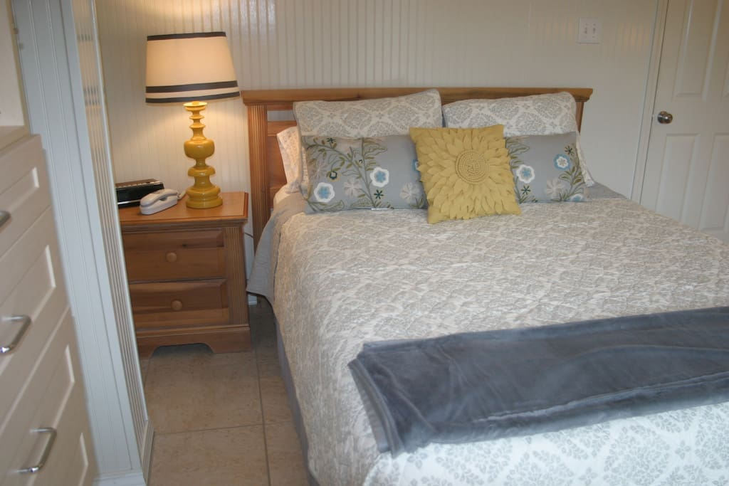 Bedroom with Comfy queen size bed.   House phone provides free long distance.
