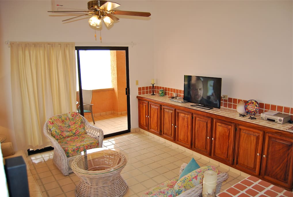 The living room has an ocean view and flat screen television