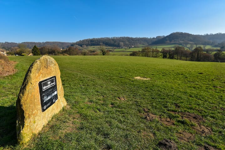 Uley Millennium Green, surrounded by green hills