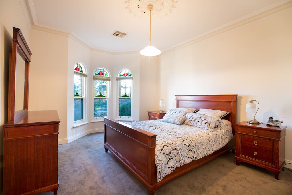 This beautiful lead-lighting in the bay window ensures just the right amount of coloured light shines into the main bedroom each morning.