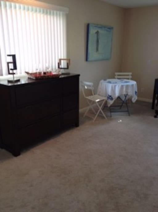 Dresser and bistro table/chairs.