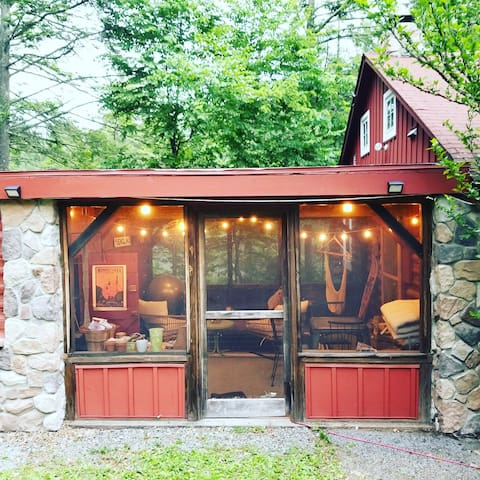 The breezeway - a lovely screened-in porch perfect for rainy days and board games