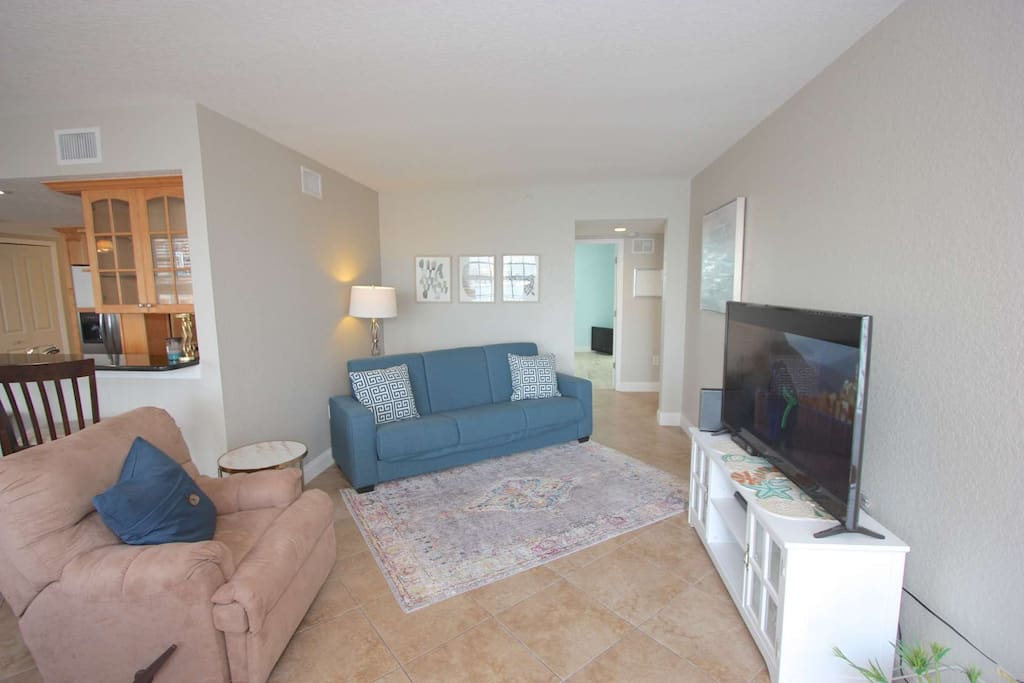 Enjoy some Family Time after a day at Clearwater Beach in this Lovely Living Area with Flat Screen TV, and Sleeper Sofa