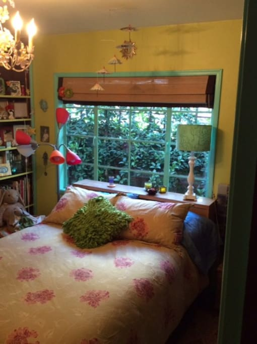 Comfy double bed in colorful bedroom.