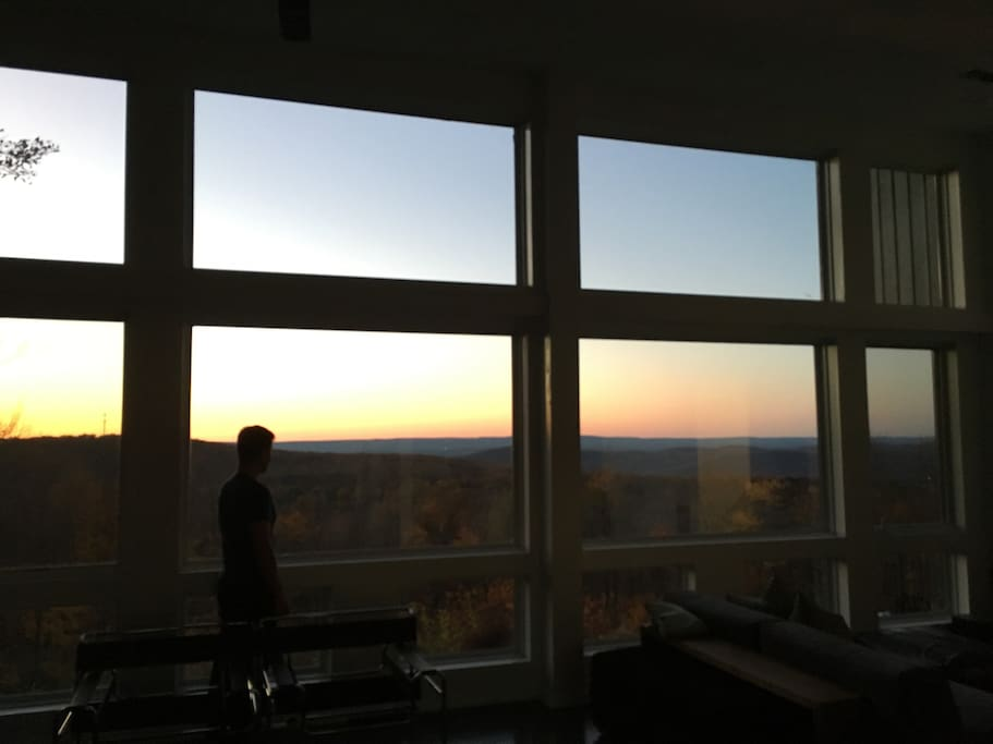 Stunning sunset views from the living room's 14' ceilings and floor to ceiling windows.