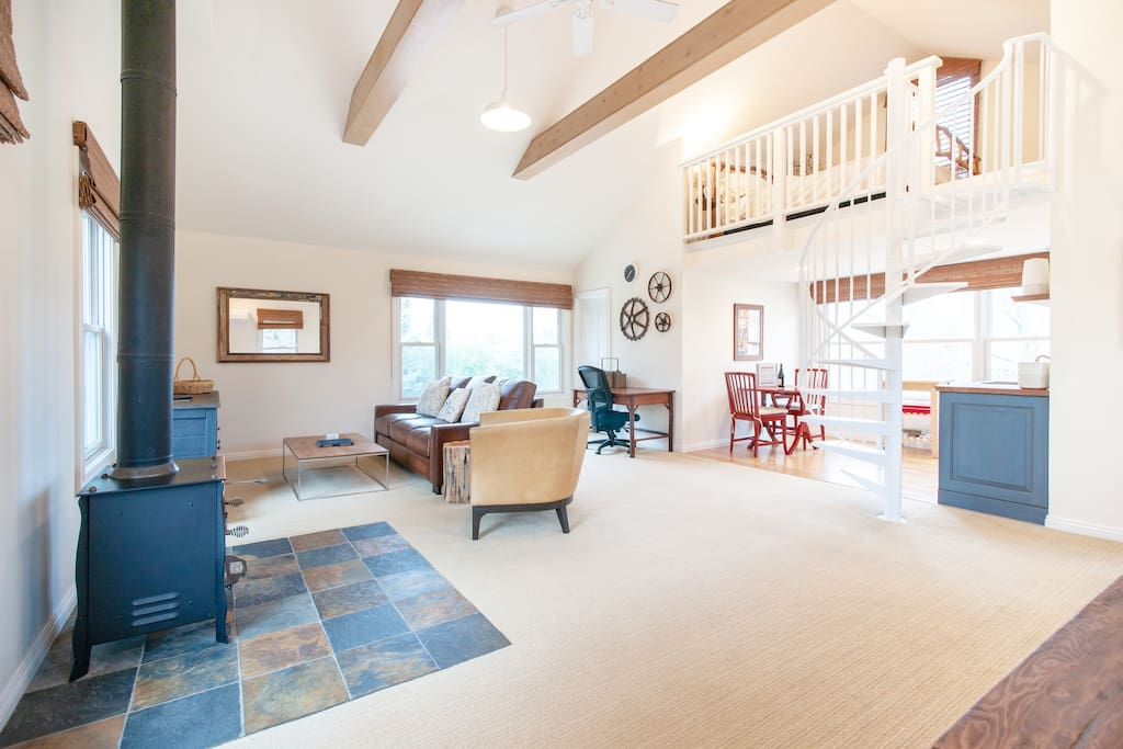 The guest house has ample space, with a loft bed, desk, a kitchenette, dining area, a comfortable sleeper sofa, large walk-in closet, and bathroom.