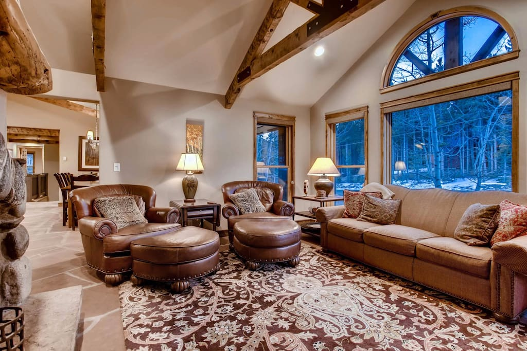 Living room with beautiful bay windows to watch the snow fall.