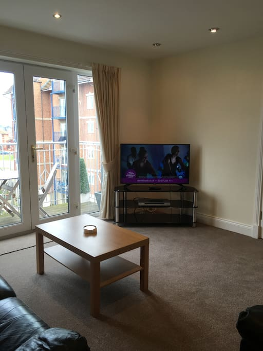 Sitting room - smart TV, DVD player, wifi access. French doors to balcony area with decking. Table and 4 chairs overlooking the West Quay Marina.