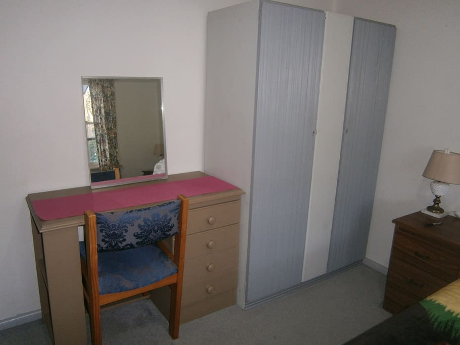 Desk with chair and double wordrobe in the bedroom