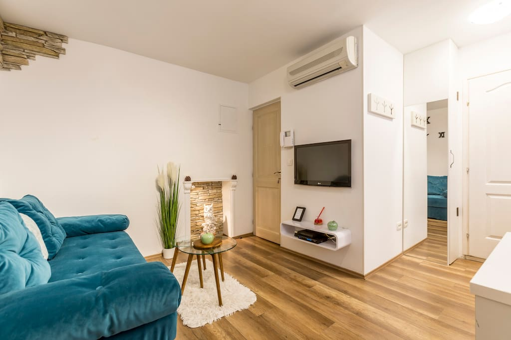 Living Room with Comfortable Sofa, LCD TV and Air Condition