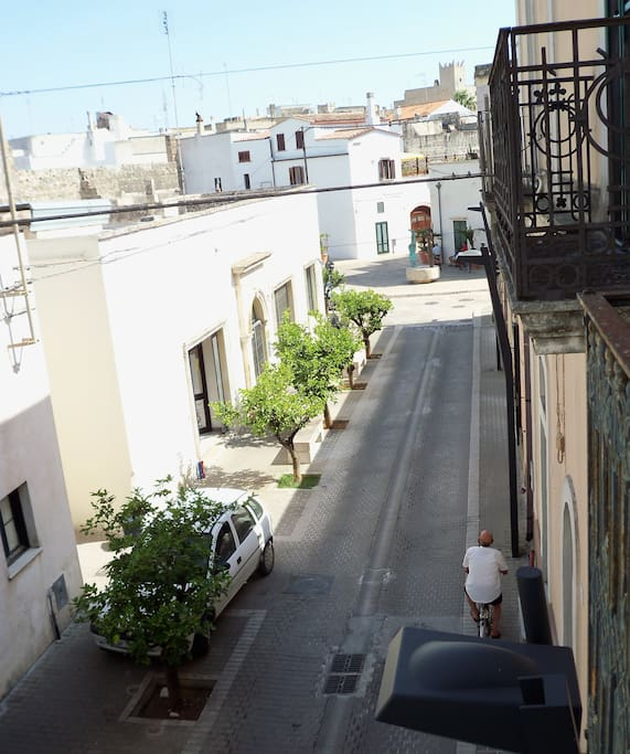 View of a small village square from the front side bedroom terrace (Via Roma)