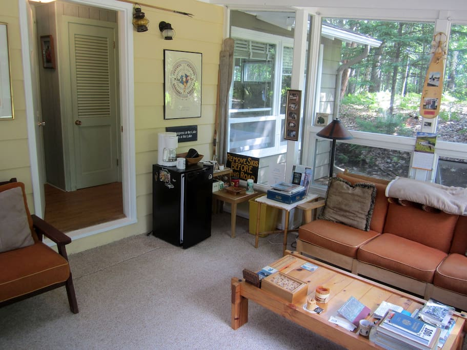 Enclosed porch with windows to let in the fresh lake breeze.