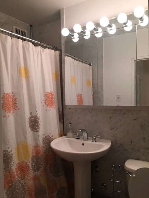 Spotlessly clean and bright bathroom