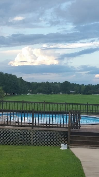 Ranger style house in a country setting but close to Richmond Airport and downtown Richmond.  Back yard with pool.  Awesome view from back deck.  Huge front deck as well.  Will post picture of the front of the house soon.