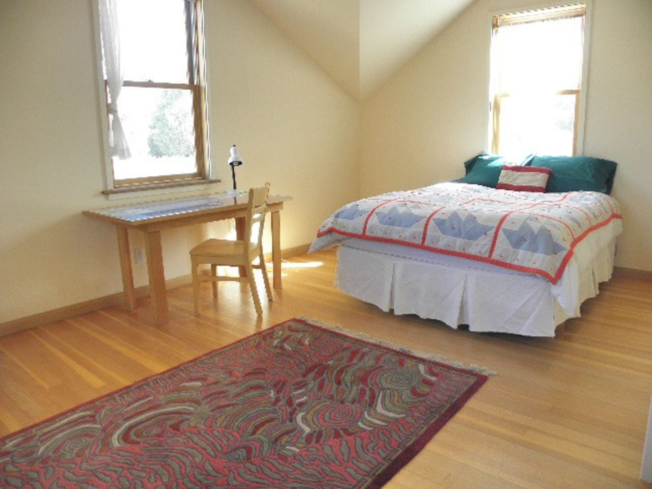 The upstairs bedroom is spacious and bright. Lovely space for yoga or relaxing.