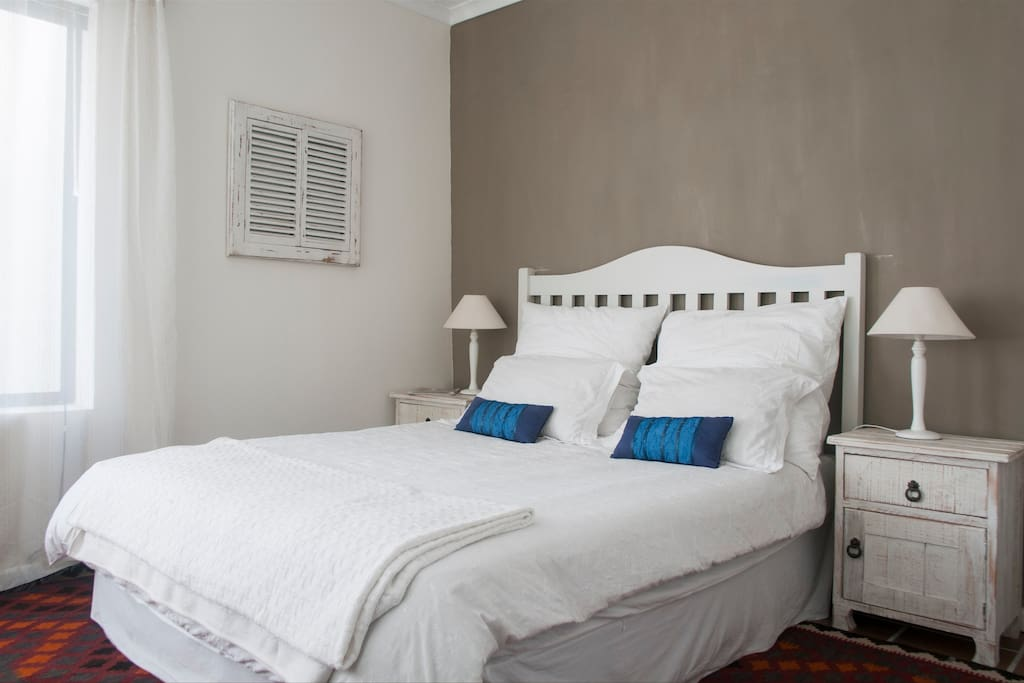 Comfortable Bedroom with white linen