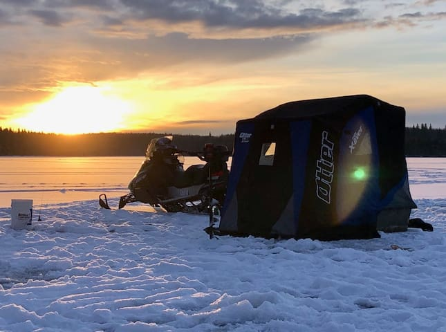 Ice Fishers and snowmobilers Haven on the lake