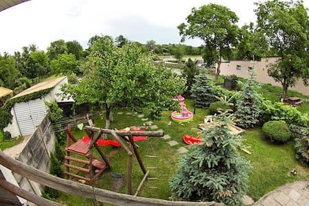 Mieszkanie w domku z ogródkiem - Sieradz