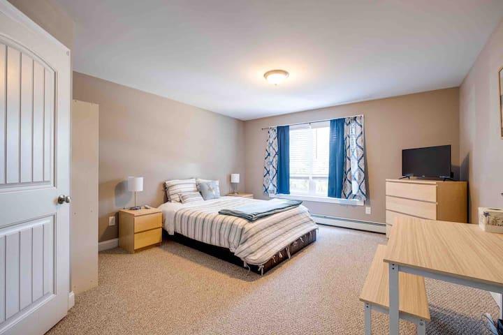 1 sleep number extra wide queen bed in Primary bedroom, en suite bathroom, as well as a walk-in closet. Smart tv provided.