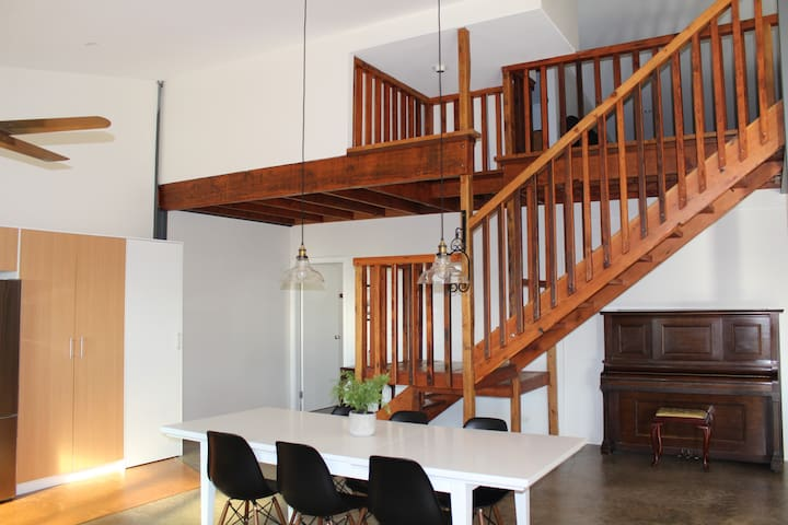 Dining with stairs leading to bedrooms 3 and 4