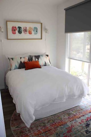 Fresh and light bedroom with plenty of hanging space and full block out blinds