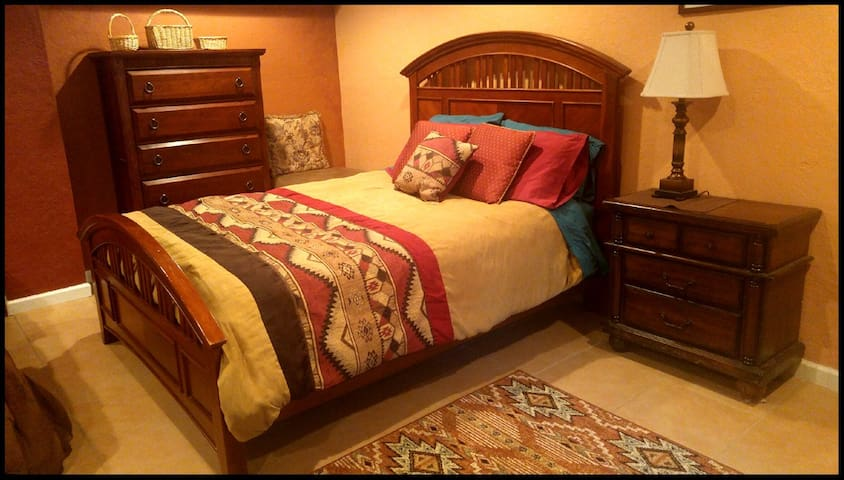 The cherry wood bed and chests of drawers are inviting.