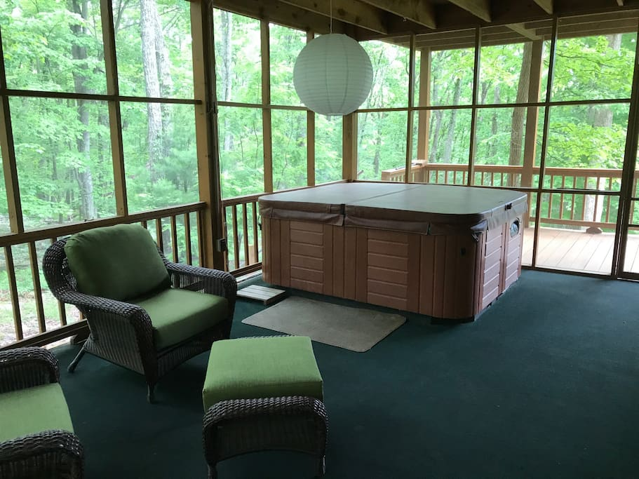 Bedroom opens out to hot tub and quiet seating.