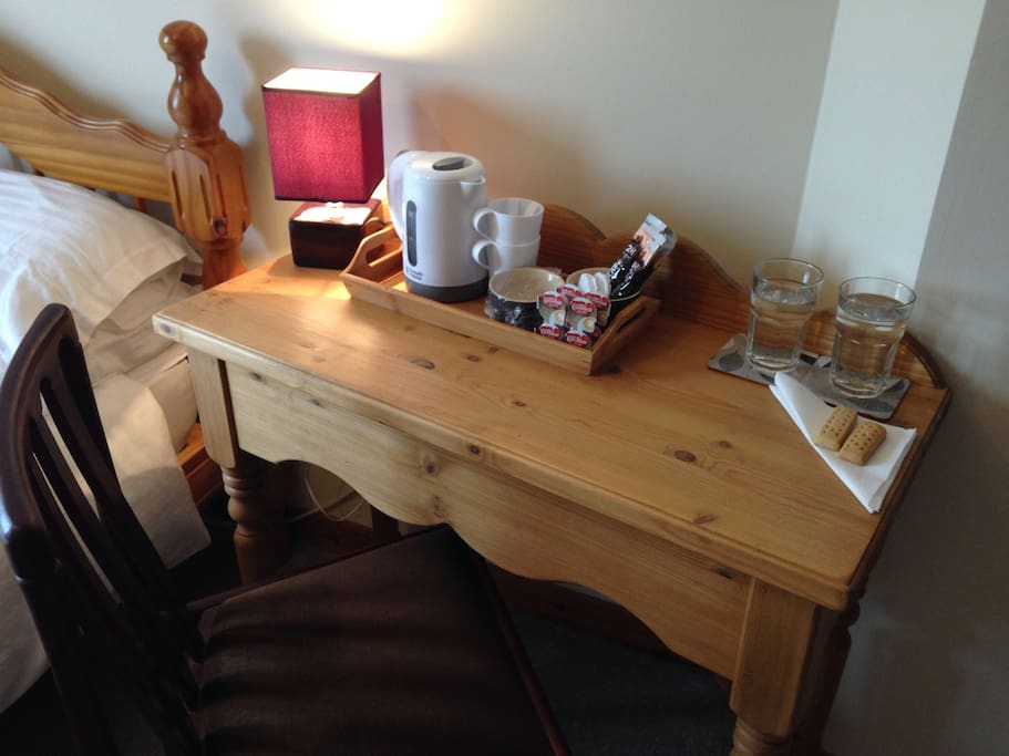 Console table and chair, with complementary tea & coffee making facilities.