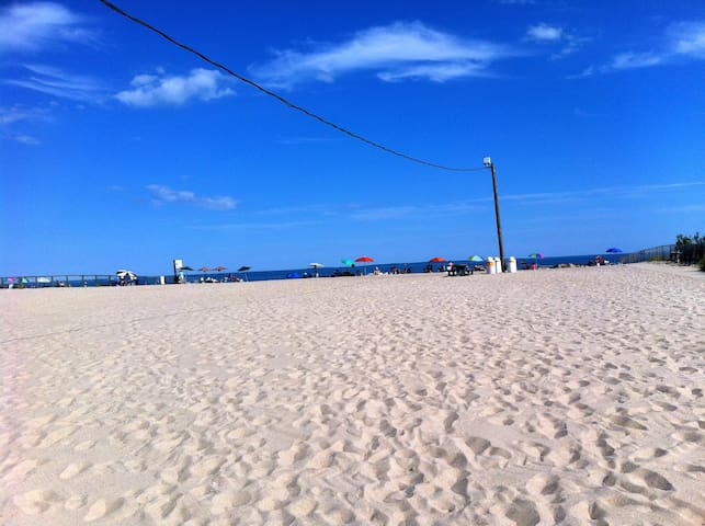 Only steps to the beach and a short walk to local beach attractions, carousel, ice cream and bars.