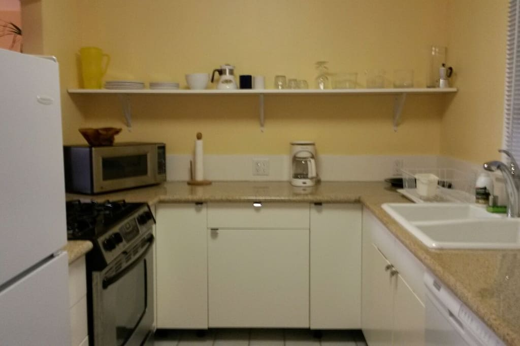 Full size kitchen with refrigerator,  microwave,  coffeemaker,  stove/oven and dishwasher.
