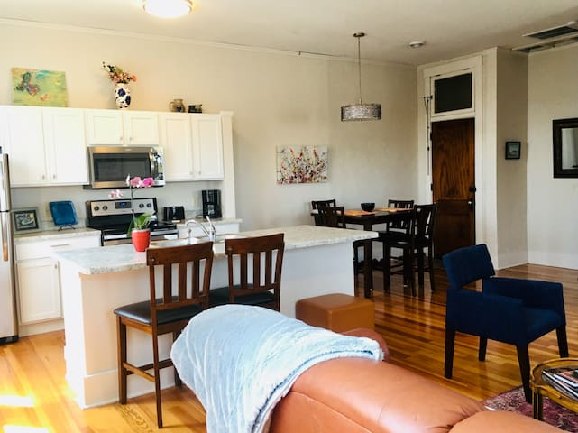 Modern, updated kitchen with fridge, stovetop with oven, microwave and dishwasher.