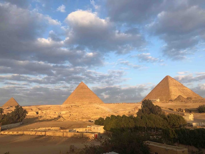 Sphinx palace pyramids view