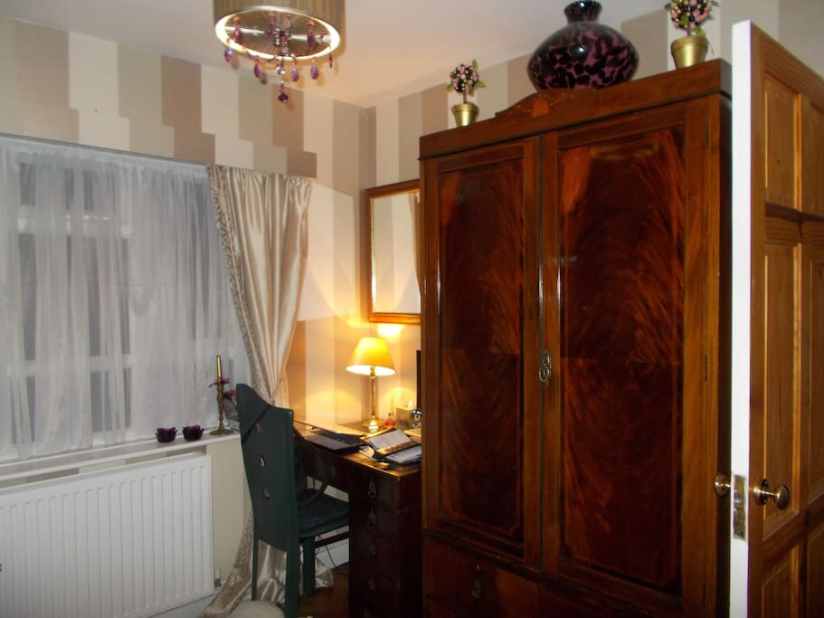 Antique, double wardrobe with drawers under; antique desk, television; wi-fi.