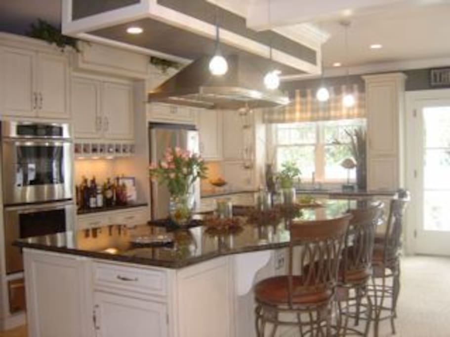 11-foot granite island, perfect for cooking, entertaining and socializing