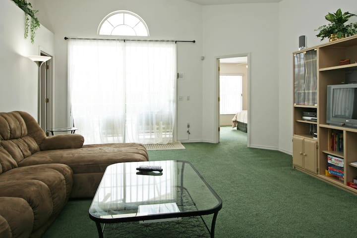 Spacious great room, open plan and ideal for families.  Watch a movie or have game night.