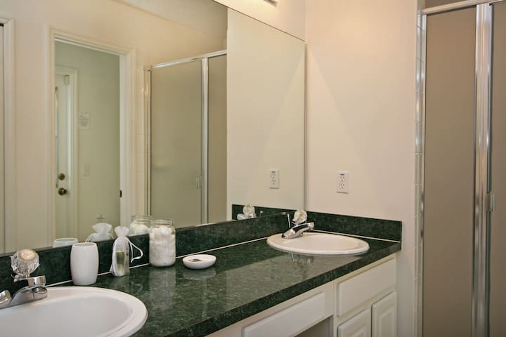 Spacious washroom with double sinks.