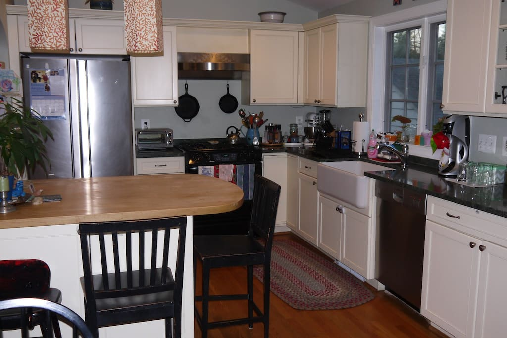 Open kitchen/dining area with gas stove, modern appliances and all the gadgets you can imagine.