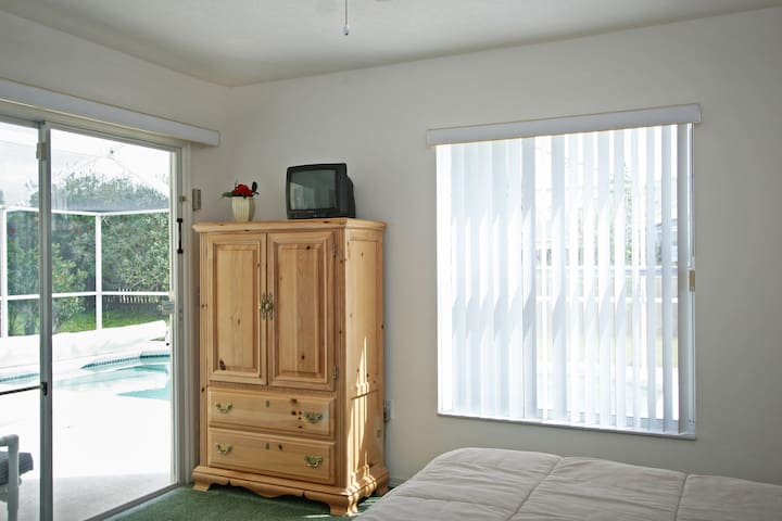 View to the pool from the queen bedroom. (TV no longer present)