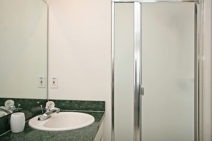 Spacious showers with multi-head  showers.