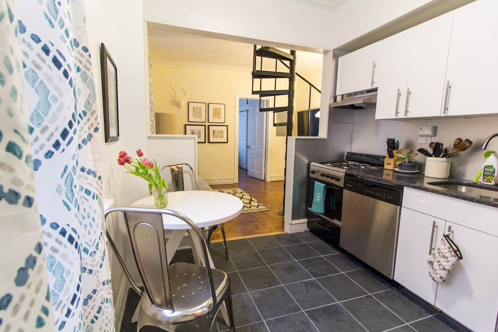 The eat-in kitchen opens to the living room
