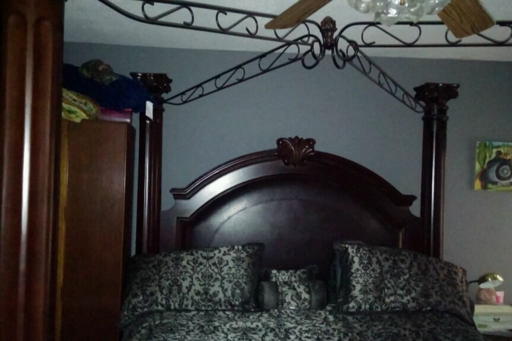 King size canopy bed in master.