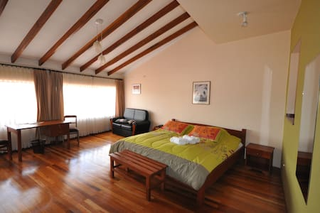 Casa Kolping Sucre, double room with mountain view and private garden setting
