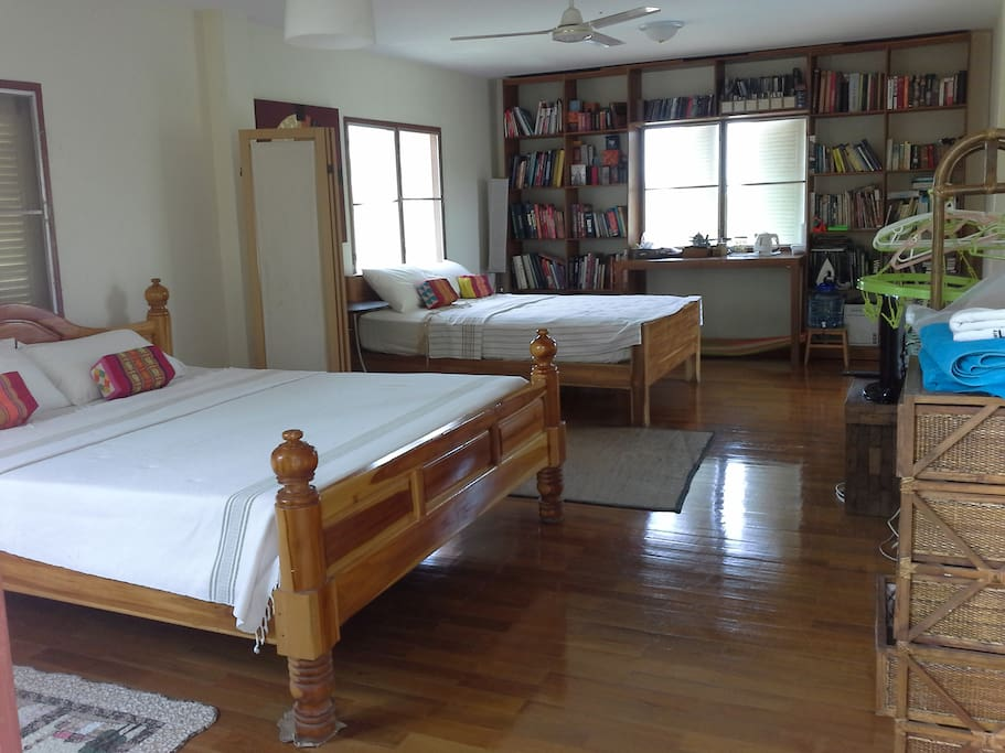 Large comfortable room with bookshelves and sea breezes