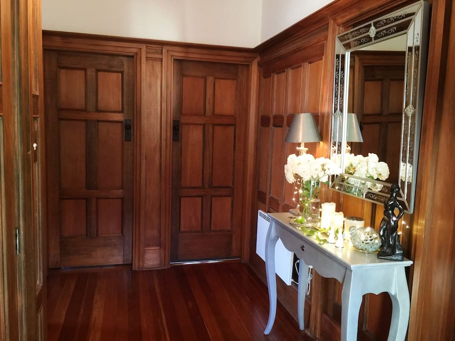 Entrance with gorgeous wood paneling and polished floor