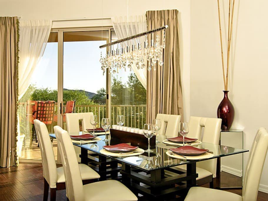 Dining table set for 6.  Will seat 8.  Outside lounge area through patio doors.